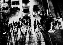 Crossing the Avenue at Night in Paris (high contrast B&W) (Ricardo Carreon) Tags: girls people blackandwhite bw paris france men cars blancoynegro boys night noche topf50 pessoas topv333 women crossing shadows gente pedestrian pb topv222 vehicles carros noite feed lamps mulheres autos soir mujeres francia pretoebranco sombras beams coches hombres homens pedestrianx pietons peatonal tamron28300mm challengeyouwinner aplusphoto