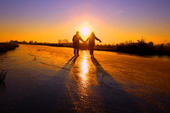 Lovers on ice. (kees straver (will be back online soon friends)) Tags: winter light boy sunset people woman man holland reflection love ice girl amsterdam landscape kiss couple bevroren iceskating skating nederland thenetherlands romance lovers riet liefde sloot schaatsen koud holysloot elfstedentocht ransdorp natuurijs abigfave keesstraver schaatsgekte skatingmadness skatingonnaturaleice