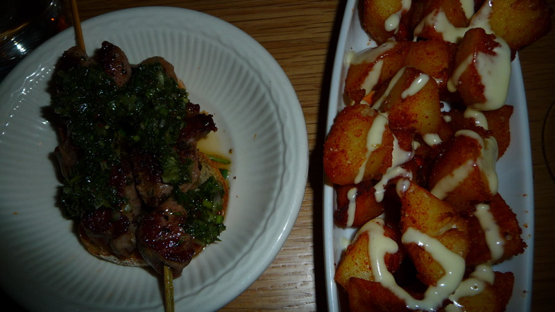 Lamb skewers and patatas bravas at Boqueria Soho