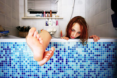 Chilling in the Bathtub (hannes.trapp) Tags: blue woman feet girl face canon bathroom foot eos women bath toes toe sandra zimmer kacheln bad cyan creepy tub bathtub badewanne frau badezimmer sigma1020 franzis 400d roughstyle img42547