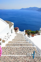 Gate to the sea (Netfalls) Tags: travel cruise blue sea summer white holiday plant seascape ferry umbrella table island greek volcano hotel boat gate mediterranean ship looking view apartment chairs balcony postcard aegean sunshade explore santorini greece gateway tropical archway welcome vacations scenics