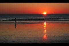 RuN II (RoOoOo!!!) Tags: ocean sunset sea sky sun luz sol beach sport mar sand playa run arena cielo reflejo cadiz deporte oceano correr orilla cortadura