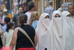 Three women with white niqab