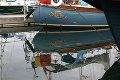 Clouded Reflection (ladydipim) Tags: ocean reflection sailboat mywinners goldstaraward