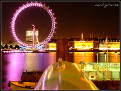 London Eye at Night (david gutierrez [ www.davidgutierrez.co.uk ]) Tags: street city uk greatbritain travel pink light england urban sculpture reflection building london eye colors yellow thames architecture modern night buildings dark spectacular photography pier photo interestingness cityscape darkness riverside image unitedkingdom britain dusk walk centre cities cityscapes londoneye landmark center icon structure architectural explore nighttime finepix londres architektur nights fujifilm sensational metropolis pointing topf100 londra impressive offices countyhall nightfall municipality edifice cites 100faves s6500fd s6000fd fujifilmfinepixs6500fd