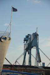 "USS Salem: Ships bow flag & nearby General Dynamics shipyard crane ""Goliath"" (Chris Devers) Tags: ocean city bridge sea building water car shop skyline museum architecture river ma quincy boat store ship lift unitedstates arm crane flag massachusetts navy machine vessel company maritime vehicle drawbridge salem nautical goliath naval 2008 usnavy weymouth cruiser uss warship coldwar liftbridge shipbuilding quincyma foreriver usssalem heavycruiser foreriverbridge ca139 cameranikond50 forerivershipyard weymouthma exif:exposure=0002sec1640 exif:iso_speed=200 exif:focal_length=75mm unitedstatesnavalshipbuildingmuseum exif:aperture=f53 exif:exposure_bias=06ev camera:make=nikoncorporation camera:model=nikond50 meta:exif=1257954851 exif:orientation=horizontalnormal exif:filename=dscjpg meta:exif=1350405578"