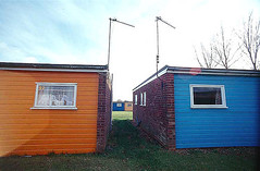 Holiday homes, Norfolk, England (YYL Photography) Tags: ocean uk blue sea vacation england orange holiday color colour building english film beach colors architecture buildings seaside nikon colours unitedkingdom britain norfolk el aerial british tamron notdigital antenna antennae nikkormat toosmall 17mm nikkormatel yylphotography