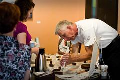 Bill Dietz dresses the Chocolate Oblivion Torte
