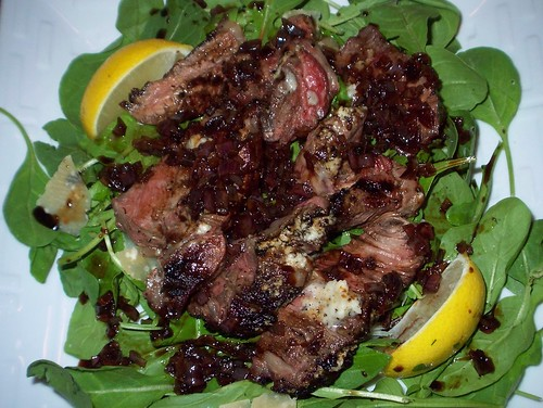 steak arugula salad with parmesan butter and balsamic glaze
