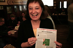 Diane holding Newsweek and looking dorky