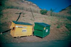 BFFs (QsySue) Tags: shadow green yellow dumpster desert hill powerlines 35mmfilm ghosttown hillside dollarstorefilm vivitarultrawideslim mentryville