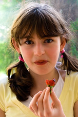 Strawberry (yeshayden) Tags: portrait girl strawberry eating chocolate earrings pigtails hairties