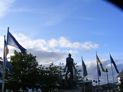 The Phoenix - Irish Republican Memorial and Flags in Crossmaglen (seanfderry-studenna) Tags: ireland irish signs scenery south political politics country border eire hunger violence bandit republican nationalist ira sinn fein monuments gaeilge gaelic troubles cultural memorials armagh cultur strikers crossmaglen hungerstrikers camlough