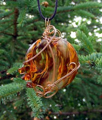 FIRE AND ICE - Wire Wrapped Cherry Quartz Pendant Adorned with Amber Chips (Care More) Tags: red orange brown ice nature yellow metal stone silver fire gold volcano amber necklace beads wire beige natural handmade stones unique ooak flames dramatic wrapped jewelry more earthy metalwork copper handcrafted swirls etsy beaded swirly pendant semiprecious gemstone smokeyquartz cabochon cabochons silver stone copper wire gold care wire caremore silver jewelry sterling creations wrapped wirewrapped pendant semiprecious