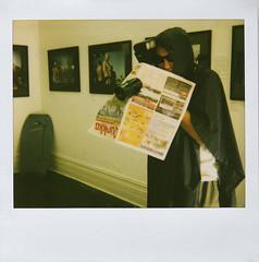 Beware men with raincoats and long lenses (sengsta) Tags: polaroid raincoat graham pervert longlens polaroidspectraonyx instandfilm