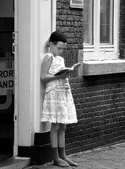 READING IN FRONT OF THE BOOKSHOP (Akbar Simonse) Tags: people bw holland netherlands girl reading book boek zwartwit candid thenetherlands streetphotography denhaag bookshop thehague streetshot bwdreams boekenwinkel infinestyle theperfectphotographer 200000000stagelovers akbarsimonse
