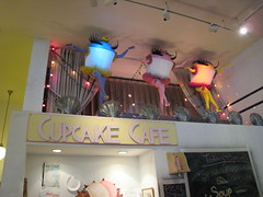 Dancing Cupcakes (fertree33~Jen Bowles) Tags: pink blue yellow cafe display cupcake whimsical booksofwonder newyorkcityshops