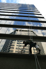 My Continuing Obsession with Window Washers II: Cleaning a Reflection on St Clair Ave. East, Toronto (Tony Lea) Tags: from windows summer favorite toronto ontario canada man reflection tower window up st danger canon outdoors rebel reflecting office dangerous chair looking stclair centre manatwork over working officebuilding best tony cleaning clean sidewalk wash maintenance lea anthony hanging government worker below tall suspended ropes yonge bent favourite windowwasher wipe 2008 job reflexions federal hang clair washer squeegee weston workman profession tallbuilding loblaws smrgsbord bosun bosuns cotcpersonalfavorite wittington goldstaraward rubyphotographer tonylea unusualviewsperspectives thisimagemaynotbeusedinanywaywithoutpriorpermissionallrightsreserved2009 anthonylea