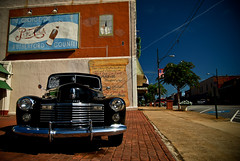 Time Travel (shiphome) Tags: history classic vintage mainstreet downtown oldbuildings headlights grill chrome indiansummer blackpaint rutherfordcounty 1941cadillac us221 rutherfordtonnc pepsimural teamshipaway clearblueseptembersky hotsunshine