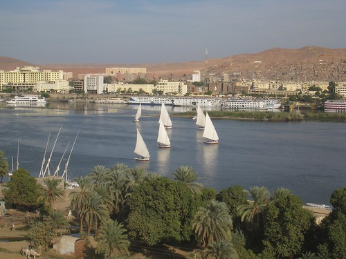 Feluccas sail in front of Aswan on the Nile River.