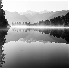 Cook, Tasman, Matheson (AndrewNZ) Tags: morning newzealand mist lake mountains reflection topf25 topv111 wow topf50 topv555 topv333 topf75 topv444 topv222 hasselblad 500c topv777 southernalps topv666 ilford lakematheson evaporation mountcook mounttasman tewaipounamu panfplus50 interestingness220 i500 explore29jan09 committeeofartists