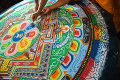 His Holiness Dagchen Rinpoche's hand holds a vajra drawing lines that close the Hevajra Mandala, after the empowerment, Tharlam Monastery of Tibetan Buddhism, Boudha, Kathmandu, Nepal (Wonderlane) Tags: travel nepal art religious sand ancient colorful hand bright path buddha buddhist traditional famous religion plan buddhism palace blessing creativecommons figure offering leader colored lama tibetan kathmandu grains draw tradition drawn spiritual visualization enlightenment powerful result rinpoche holds tantra initiation boudha tantrica vajra tantric empowerment sakya meditations yogic consecrated definate tibetanbuddhist tibetanlama 5307 drawi