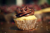 milk chocolate frosting (ginnerobot) Tags: cute dessert 50mm cupcakes baking bokeh chocolate cupcake sprinkles icing bakedgoods