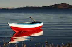 Row Boat (cormend) Tags: travel light mountain lake color reflection peru reed laketiticaca titicaca southamerica water landscape lago boat nikon colorful br rowboat sudamerica lagotiticaca d80 llachon cormend b2012