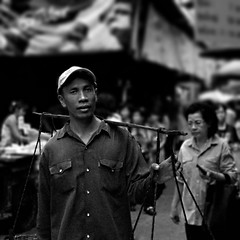 Street vendor (mr.beaver) Tags: street city people urban bw white man black thailand nikon market bangkok creative streetphotography commons creativecommons coolpix vendor p5000 siriraj mrbeaver