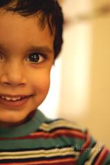 Loving eyes.. (Julie™) Tags: boy baby smile eyes toddler julie child stripes