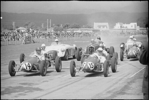 Cars on the Levin racing circuit, ca 1956 by National Library of New Zealand.