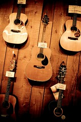 Guitar Tilting (Celine Chamberlin) Tags: music wall oregon guitars musical acoustic instruments cartwrights stayton cartwrightsmusicrepairshop