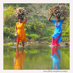 Dancing in the River (Araleya) Tags: life leica nepal people river peace happiness calm panasonic human unescoworldheritage tranquil chitwan southasia uplifting fz50 afternoondelight peoplewatch beautfiul araleya saarc leicadigital colorphotoaward sauhara earthasia beautfiullife beautfiulmoment budiraptiriver chitwannationpark fewawildliferesort
