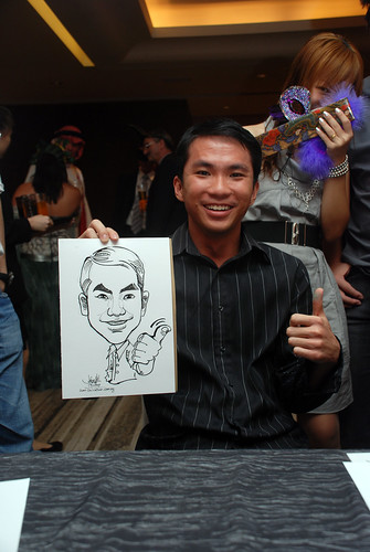 Caricature live sketching for Ezra Holdings 9