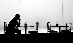 Just in for a coffee (Gremxul) Tags: people blackandwhite bw monochrome silhouette composition contrast cafe nikon malta sliema surfside d80 blackwhitephotos nikond80 1on1shadowsilhouettesphotooftheweek 1on1shadowsilhouettesphotooftheweekmarch2009