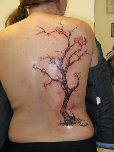 I wonder what fascinated this gal to get this tree tattooed on her back.
