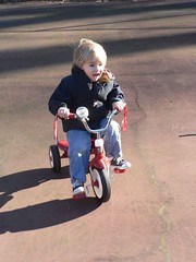 D riding his tricycle at the park