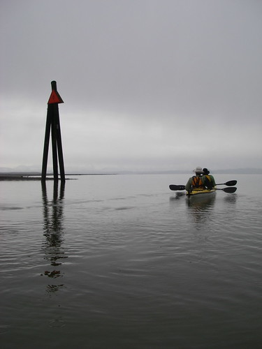kayakers and pilings