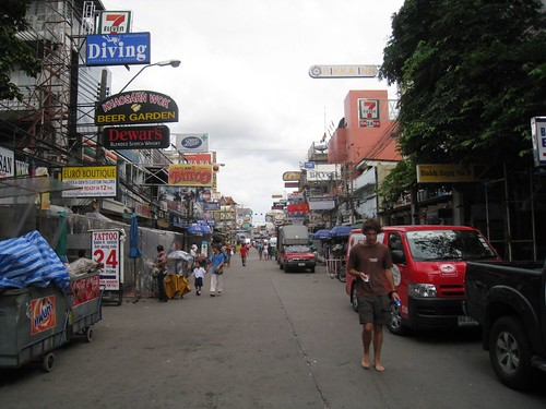 Th Khao San road by day (note the opposing, 24-hour 7-11 shops)