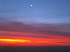 Rising of the Titans (Storm Crypt) Tags: morning red orange sun moon chicago clouds sunrise us illinois horizon gradient astronomy moonset anawesomeshot centralus
