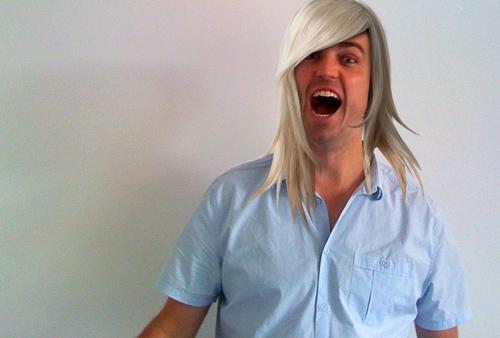 Ryan with long hair, screaming.