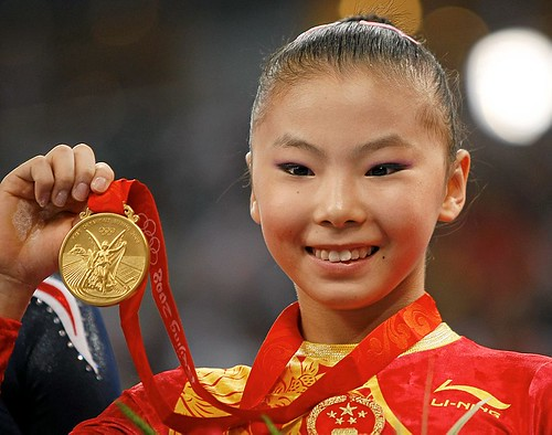 He Kexin of China holds her gold medal