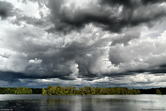 Dark clouds (taivasalla) Tags: summer cloud lake water clouds wow suomi finland dark landscape geotagged island islands cloudy maisema vesi kes jrvi saari pilvi pilvi nikond200 pilvinen jrvimaisema loppi terrascania sksjrvi tumma saaria tummia