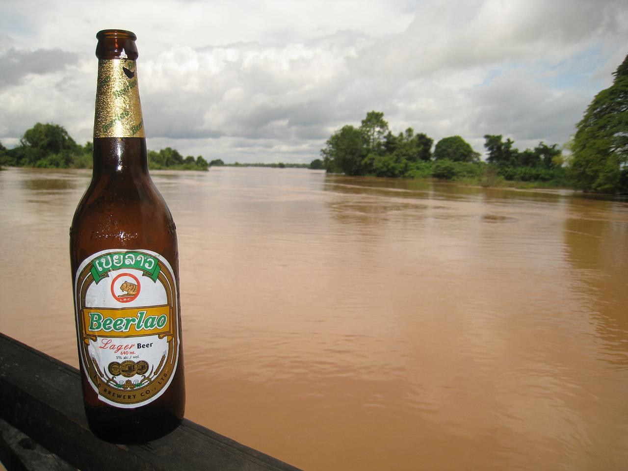 A cold beerlao is enjoyed alongside the slow-moving Mekong waters.