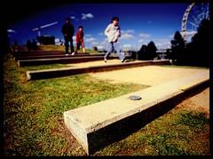 think of the children (mugley) Tags: people 120 film grass kids stairs mediumformat walking children concrete fuji dof bokeh crane path steps australia melbourne wideangle slide victoria pedestrians ferriswheel epson velvia100 polarizer 6x45 e6 urbanlandscape wideopen reversal birrarungmarr polariser v700 mamiya645protl giantskywheel fujichromevelvia100rvp oneeastmelbourne 35mmf35sekorn