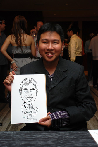 Caricature live sketching for Ezra Holdings 3