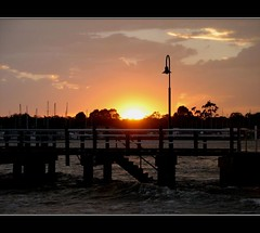 Sunset on Christmas Eve I (Millisynth) Tags: christmas bridge sunset sky storm clouds sunrise pier waves harbour jetty brisbane christmaseve tidal stormclouds sandgate hightide shorncliffe frankdoylepark