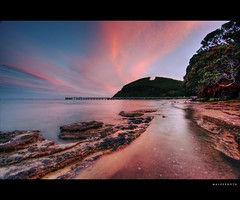 Burst of pink (Mark Emirali) Tags: pink sunset newzealand seascape colour night canon landscape rocks auckland wharf nz aotearoa 1022mm 30d copyrighted cornwallis canon30d pleasedonotusewithoutmypermission maloe4 vosplusbellesphotos maloephoto maloephotography markemirali markemiraliphotography