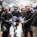 Rescuers carry the body of a victim at the Juyuan High School in Juyuan Town, Dujiangyan City, southwest China's Sichuan Province, May 13, 2008. Rescuers work against the rainy weather to search quake survivors on Tuesday. (Xinhua Photo)