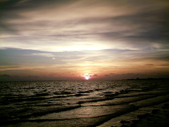 Lost at Sea (englishsnow) Tags: ocean sunset sea summer vacation beach nature beautiful clouds dark waves florida explore